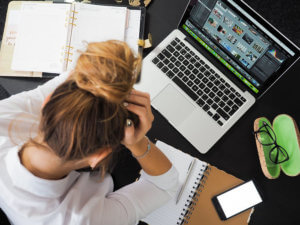 Frustrated women with cluttered desk
